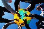 businessmen holding up globe