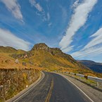 curving mountain highway in summer