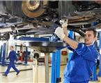 mechanic working on car suspension